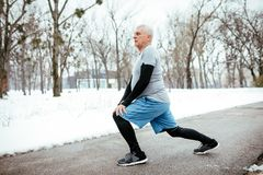 Senior Winter Stretching royalty free stock photo