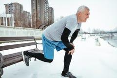 Senior Winter Stretching stock photos