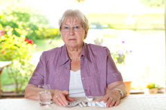 Senior wit a lot of drugs Royalty Free Stock Image