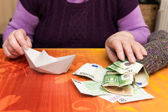 Free Senior With A Sock Full Of Money Stock Photography - 55698862