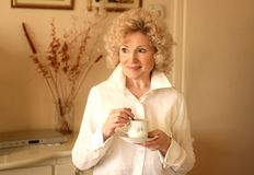 Senior woman 11. A senior woman with a cup of tea Stock Image