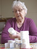 Senior woman. With her medicine Royalty Free Stock Image