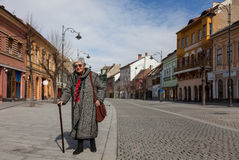 Senior woman. Image of a lonely senior woman walking in a paved city street Royalty Free Stock Photo