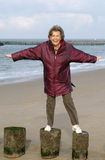Senior woman. A happy senior woman at the beach Stock Photography