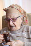 Senior woman holding a glass of coffee Royalty Free Stock Photography