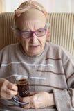 Senior woman with coffee Royalty Free Stock Photos