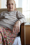 Senior woman sitting in an armchair Stock Photography
