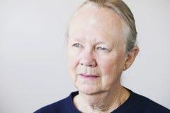Senior Woman. Portrait of a senior woman looking towards a light source Stock Photos