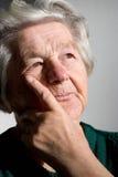 Senior woman. Elderly woman bringing back memories.Focus on her left eye Stock Photography