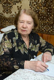 Senior woman. The elderly woman writes the letter Royalty Free Stock Images
