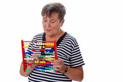 Senior woman with abacus Royalty Free Stock Images