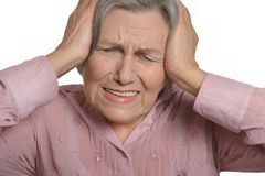 Senior Woman with Aching Head Isolated Stock Images