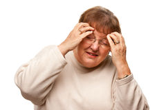 Senior Woman with Aching Head on White Royalty Free Stock Photo
