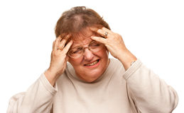 Senior Woman with Aching Head on White Royalty Free Stock Image