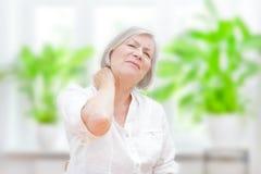 Senior woman acute neck pain. Senior woman with chronic pain syndrome fibromyalgia suffering from acute neckaches stock photo