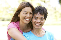 Senior Woman With Adult Daughter In Park Royalty Free Stock Images
