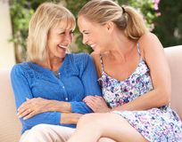 Senior Woman With Adult Daughter Relaxing At Home Stock Photography