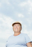 Senior woman against cloudy sky Stock Photos