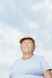 Senior woman against cloudy sky Stock Photos
