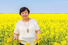 Senior woman against spring landscape Stock Photography