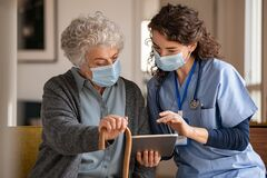 Free Senior Woman And Nurse Using Digital Tablet At Home During Consult Stock Image - 201515121