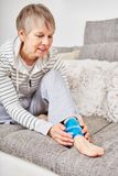 Senior woman with ankle injury royalty free stock photo
