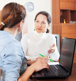 Senior woman answer questions of social worker Stock Photos
