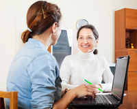 Senior woman answer questions of social worker Royalty Free Stock Photo