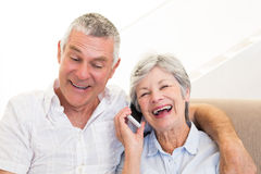 Senior woman answering smartphone Royalty Free Stock Photography