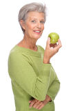 Senior woman with apple Stock Photography
