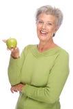 Senior woman with apple Stock Photo