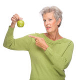 Senior woman with apple Royalty Free Stock Photo