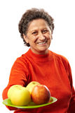 Senior woman with apples Stock Photos