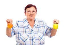 Senior woman with apples Royalty Free Stock Photography