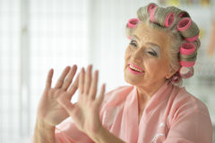 Senior woman applying make up Stock Images