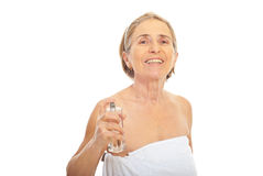 Senior woman applying perfume Royalty Free Stock Images
