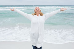 Senior woman with arms outstretched at beach Royalty Free Stock Photo