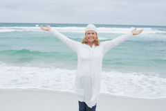 Senior woman with arms outstretched at beach Royalty Free Stock Image
