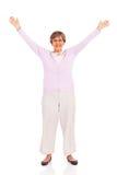 Senior woman arms up royalty free stock photo