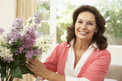 Senior Woman Arranging Flowers Royalty Free Stock Photo