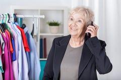 Senior woman arranging meeting. On mobile phone royalty free stock photos