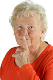 Senior woman is asking for silence Stock Photo