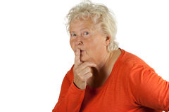 Senior woman is asking for silence Stock Photography