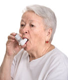 Senior woman with asthma inhaler Royalty Free Stock Photo