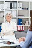 Senior woman attending a meeting in an office Stock Images