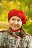 Senior woman  in autumn park Royalty Free Stock Photo
