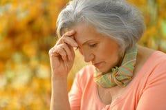 Senior woman in  autumn park Royalty Free Stock Photo