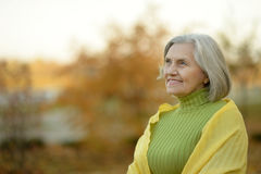 Senior woman in  autumn park Royalty Free Stock Image