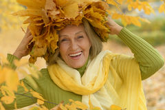 Senior woman in  autumn park Stock Images