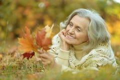 Senior woman in  autumn park Stock Image